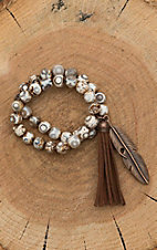Jewelry Junkie White Beaded with Leather Tassel and Feather Bracelet